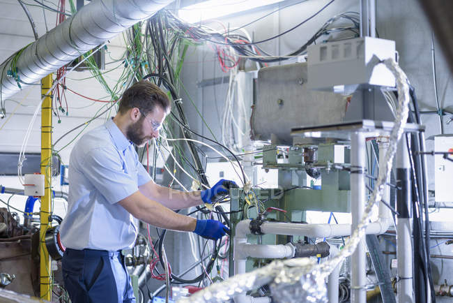 Engineer with train engine in testing bay — Stock Photo