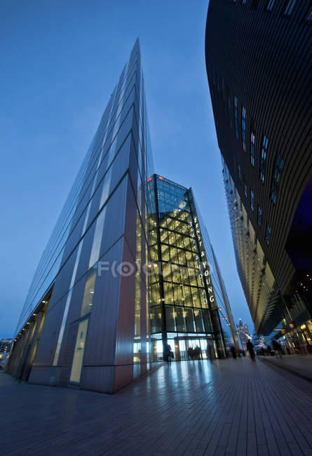 Oblique angled modern building at night, London, UK — Stock Photo