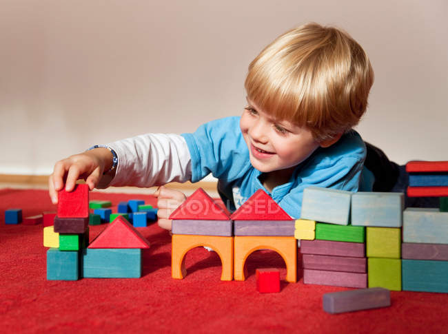 Boy with toy building blocks — Stock Photo