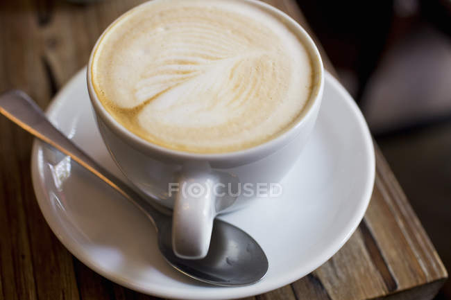 Cup of coffee on table, close-up — Stock Photo