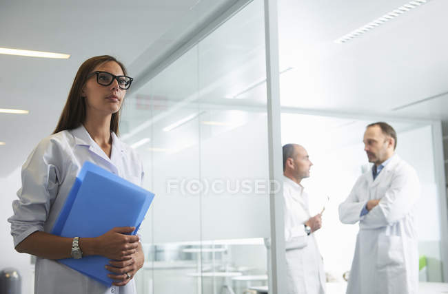 Female and male doctors at work in office — Stock Photo