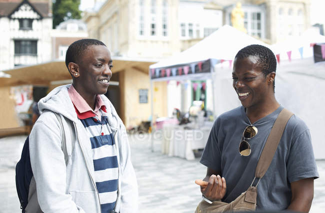 Two young male college friends chatting — Stock Photo