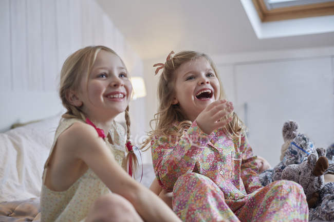 Girls laughing in loft room, focus on foreground — Stock Photo