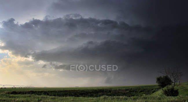 Striated wall cloud bends about updraft base — Stock Photo