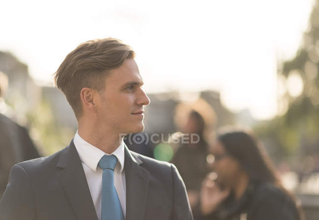 Side view portrait of businessman in suit looking away — Stock Photo