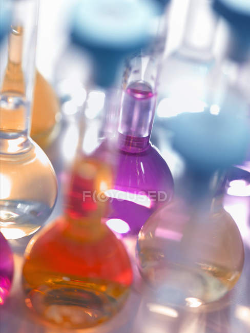 Laboratory glassware flasks containing chemicals in a laboratory — Stock Photo
