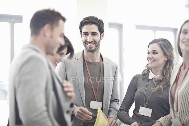 Businesswomen and businessmen in conference centre atrium — стоковое фото