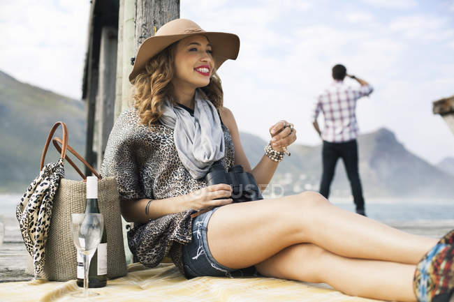 Young woman drinking wine on coastal pier, Cape Town, Western Cape, South Africa — Stock Photo
