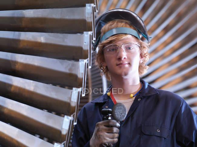 Engineer standing Next To Turbine — Stock Photo
