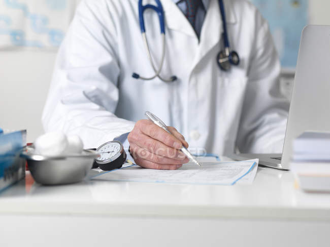 Doctor checking medical notes before prescribing treatment — Stock Photo