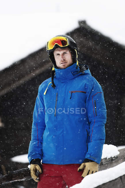Mid adult man wearing ski jacket and helmet, portrait — Stock Photo