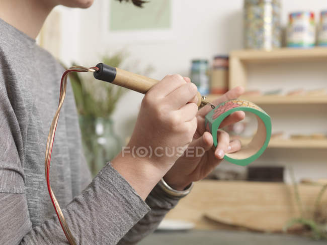 Close up of artist working on jewellery piece — Stock Photo