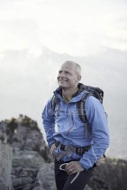 Mature man wearing blue jacket, portrait — Stock Photo