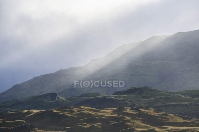 Mountain landscape with sunrays — Stock Photo