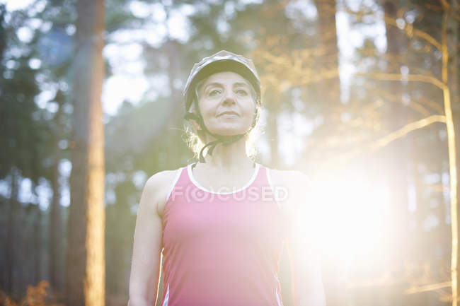 Portrait of mature woman wearing bicycle helmet — Stock Photo