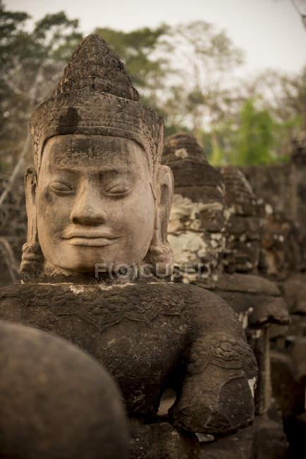 Faces of Deva and Asura, Southern Gate, Angkor Thom, Angkor, Siem Reap, Cambodia, Indochina, Asia — Stock Photo