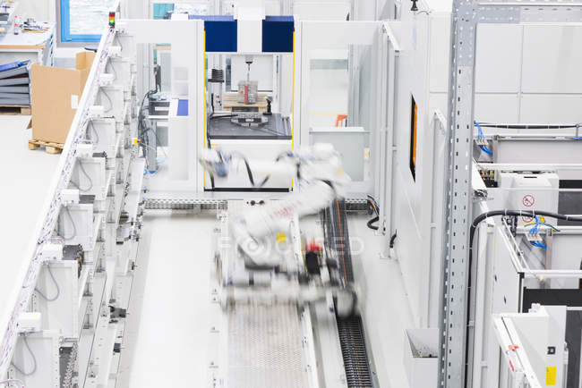 Industrial production line with moving automated robot — Stock Photo