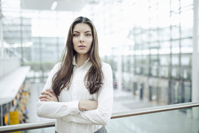 Young woman wearing white shirt, portrait — Stock Photo