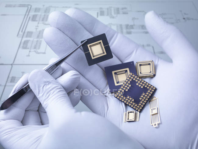 Electronic components held in hand in laboratory, close up — Stock Photo