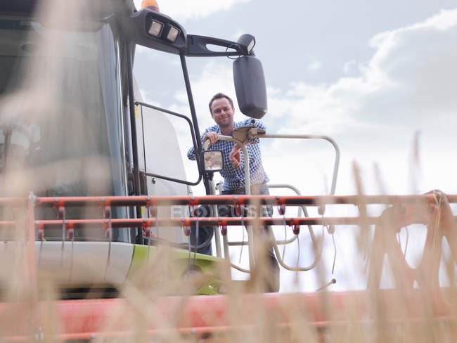 Farmer on combine harvester — Stock Photo