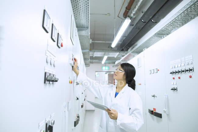 Scientist in control room — Stock Photo