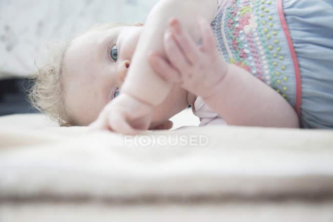 Portrait of Baby girl lying down — Stock Photo