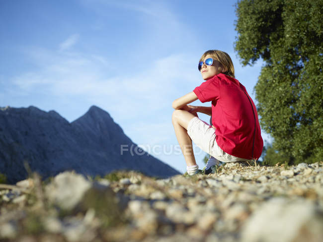 Boy sitting and gazing at mountains, Majorca, Spain — Foto stock