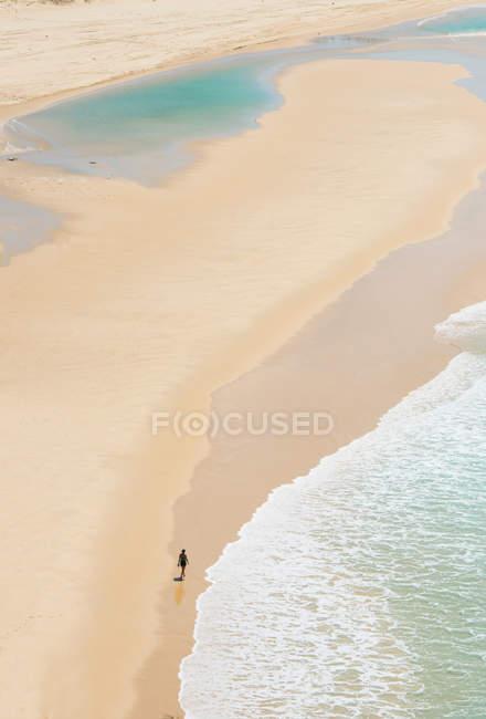 Person walking on Seventy-five Miles Beach, Fraser Island, Queensland, Australia — Stock Photo