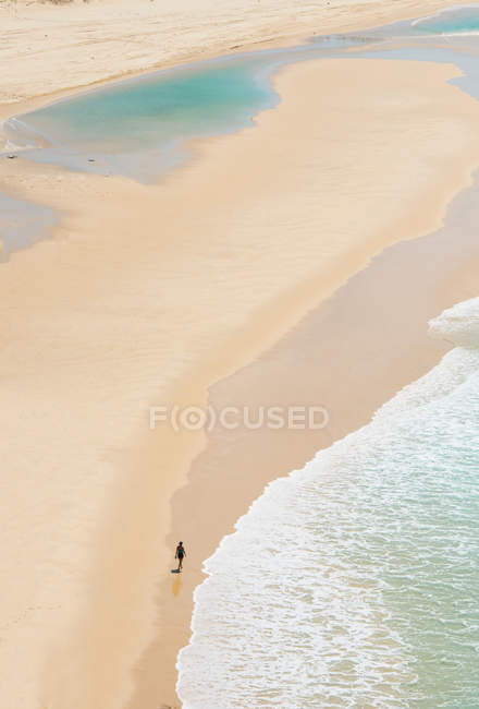 Person walking on Seventy-five Miles Beach, Fraser Island, Queensland, Australia — Stock Photo