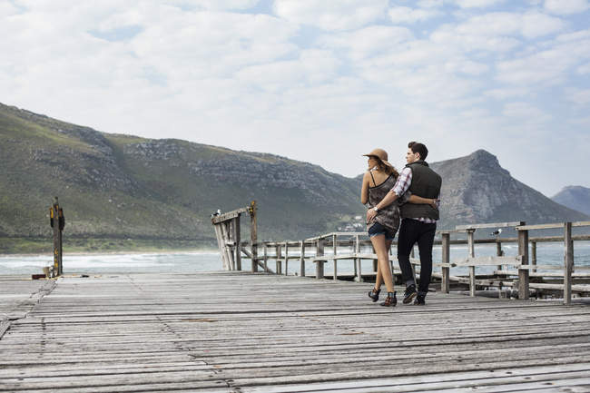 Young couple strolling along old pier, Cape Town, Western Cape, South Africa — Stock Photo