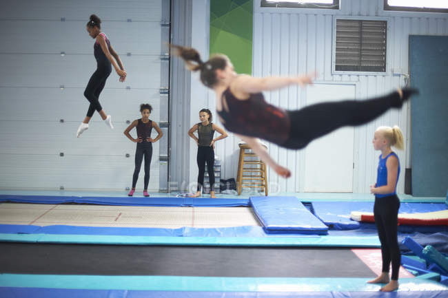 Young gymnasts practising moves — Stock Photo