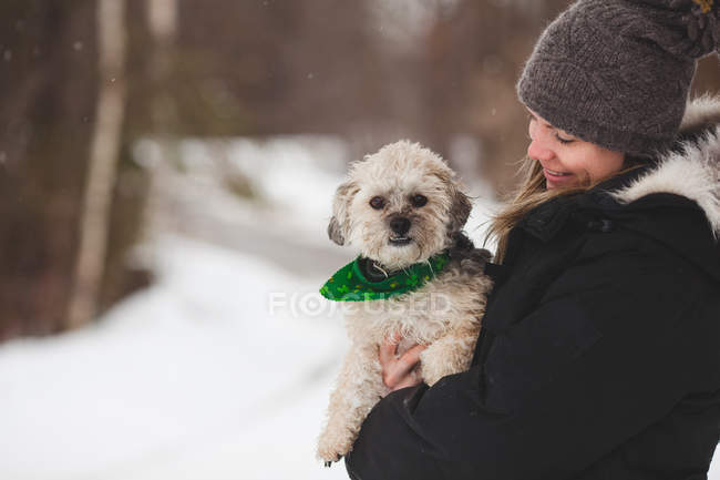 Woman with pet dog outdoors — Stock Photo