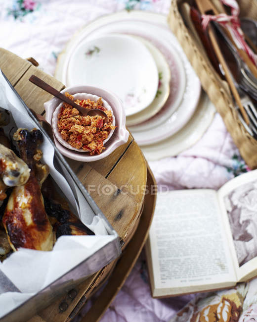 Top view of picnic with chicken legs with citrus chilli salt — Stock Photo