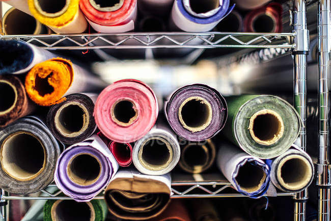 Close-up of rolls of cloth in book arts workshop — Stock Photo