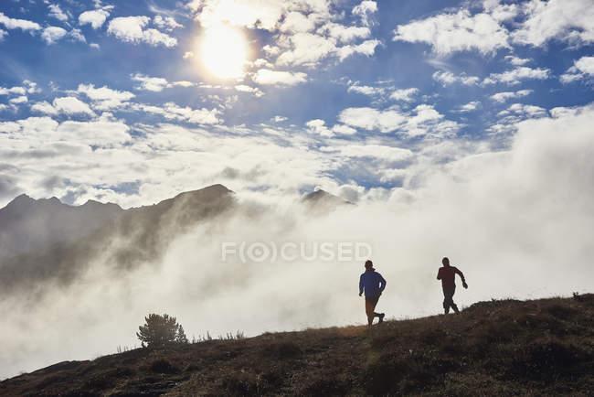 Two men trail running, Valais, Switzerland — Stock Photo