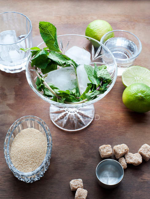 Glass with ice and mint, lime and sugar — Stock Photo