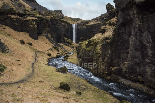 View of Kvernufoss waterfall and flowing water, Iceland — Stock Photo