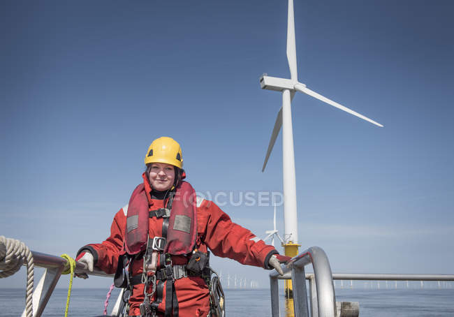 Portrait of female engineer on boat at offshore windfarm — Stock Photo