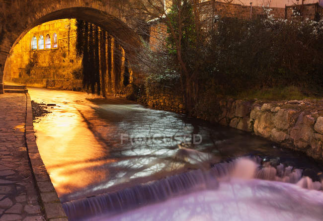 Long exposure shot of canal water flowing at night — Stock Photo