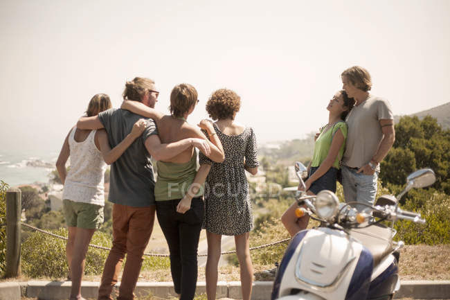 Group of friends, looking at view, rear view — Stock Photo