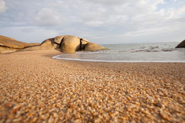 Rough sand on tropical beach — Stock Photo