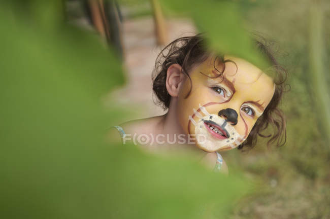 Girl with face painting of animal — Stock Photo
