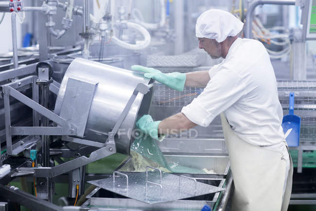 Male worker working in organic tofu production factory — Stock Photo