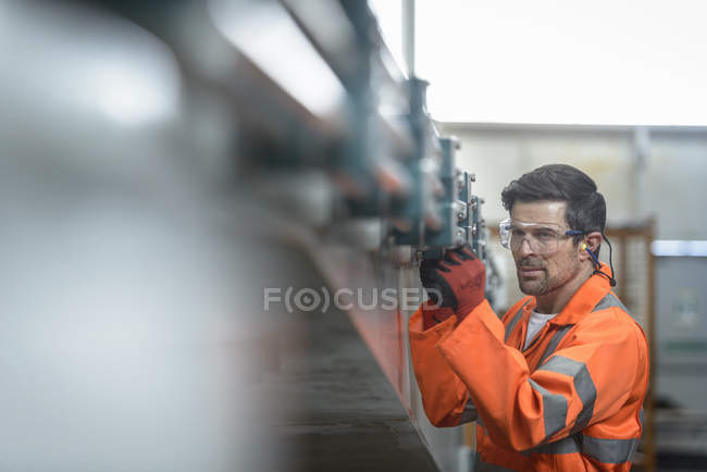 Engineer inspecting marine fabrication used for cable laying, close-up — Stock Photo