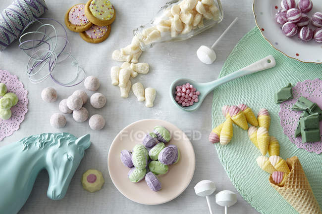 Top view of colored different sweets on table in kitchen — Stock Photo