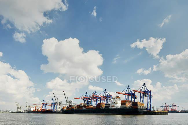 Port of hamburg under blue sky with clouds, hamburg, germany — Stock Photo