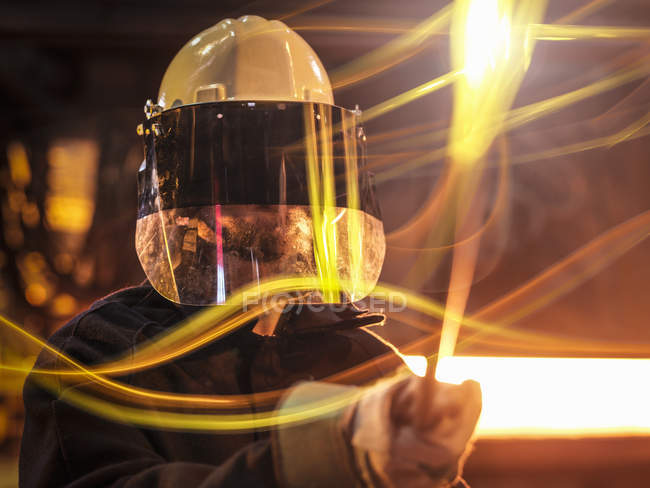 Closeup shot of factory worker with covered face in foundry — Stock Photo