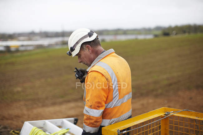 Engineer working at wind farm construction site — Stock Photo