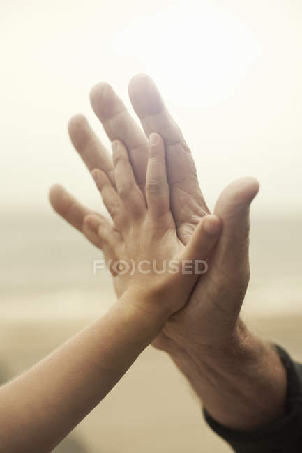 Close up of grandfathers and granddaughters hands — Stock Photo