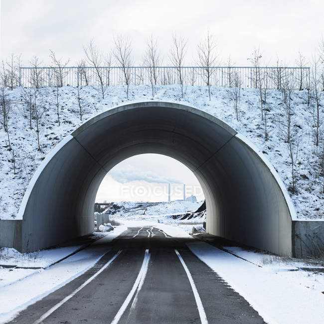 Road going through tunnel at wintertime — Stock Photo